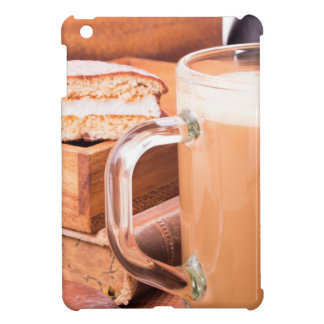 Glass mug with hot chocolate on a table case for the iPad mini