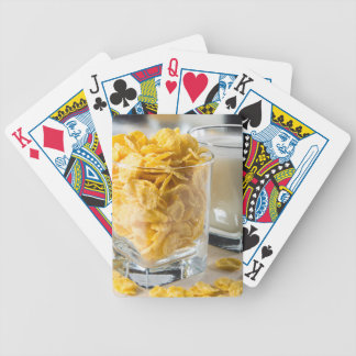 Glass of dry cereal and a glass of milk bicycle playing cards