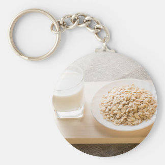 Glass of milk and a plate of cereal closeup keychain