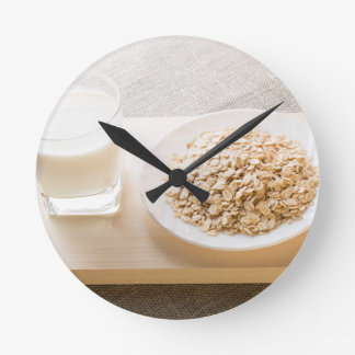Glass of milk and a plate of cereal closeup wallclock