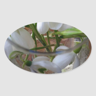 glass of snowdrops oval sticker