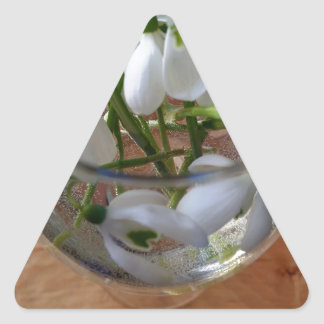 glass of snowdrops triangle sticker