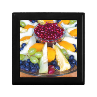 Glass scale full of various fresh fruits gift box