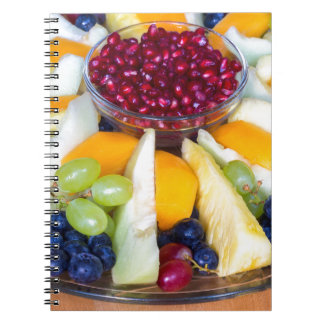 Glass scale full of various fresh fruits notebook