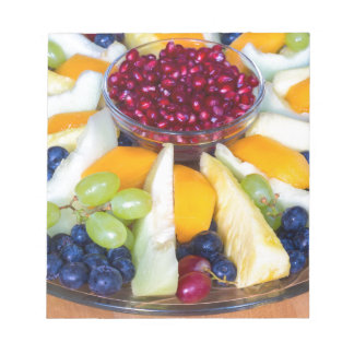 Glass scale full of various fresh fruits notepads