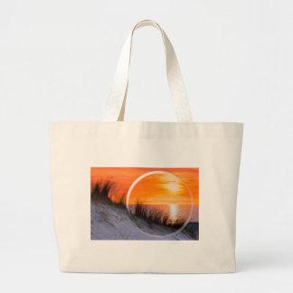 Glass sphere reflecting orange sunset large tote bag