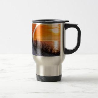 Glass sphere reflecting orange sunset travel mug