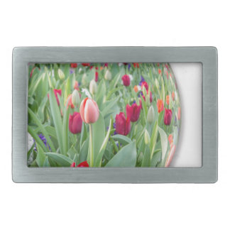 Glass sphere reflecting red tulips flower belt buckles