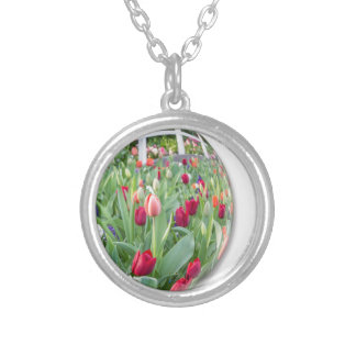 Glass sphere reflecting red tulips flower silver plated necklace
