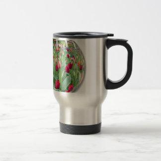 Glass sphere reflecting red tulips flower travel mug