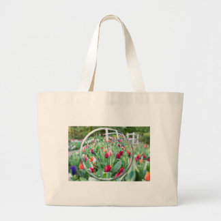 Glass sphere reflecting tulips flowers large tote bag