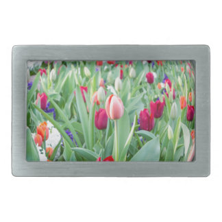 Glass sphere reflecting tulips flowers rectangular belt buckles