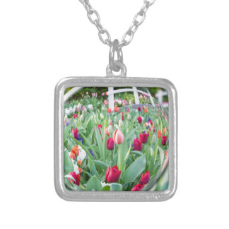 Glass sphere reflecting tulips flowers silver plated necklace