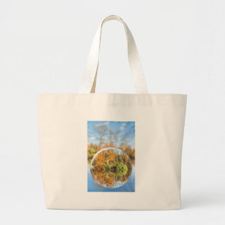 Glass sphere with autumn nature reflection in it large tote bag