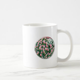 Glass sphere with red white tulips on white coffee mug