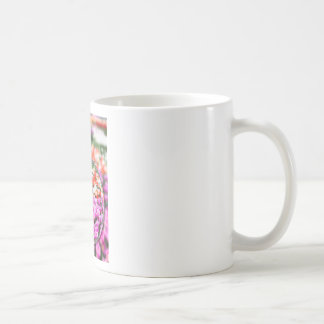 Glass sphere with various tulips in flowers field. coffee mug