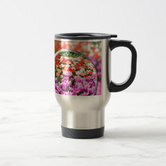 Glass sphere with various tulips in flowers field. travel mug