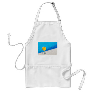 Glass with orange juice on edge of swimming pool standard apron