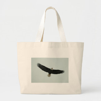 Gliding bald eagle large tote bag