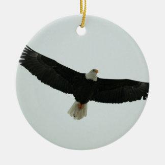 Gliding bald eagle round ceramic ornament