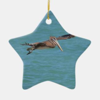 Gliding Pelican Ceramic Star Ornament