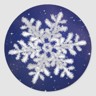 Glittering silver white snowflake on night sky classic round sticker