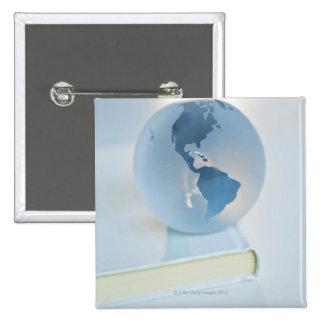 Globe on a book 2 inch square button