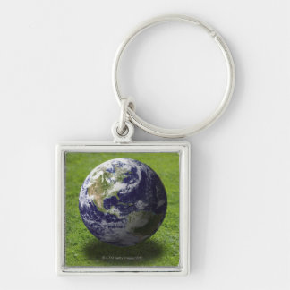 Globe on lawn 3 Silver-Colored square keychain