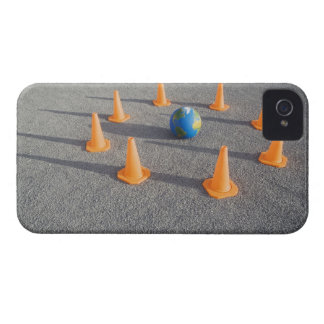 Globe on sand outdoors surrounded by traffic Case-Mate iPhone 4 case