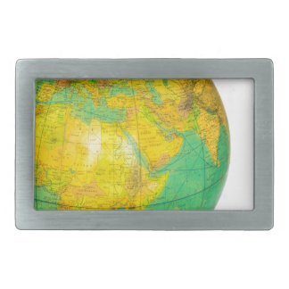 Globe with planet earth isolated on white belt buckles
