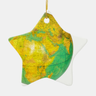 Globe with planet earth isolated on white ceramic star ornament