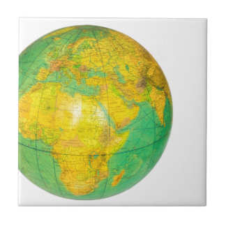 Globe with planet earth isolated on white tile