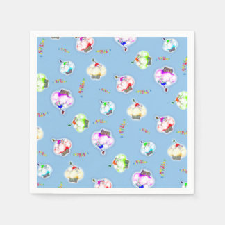 Glowing colored cupcakes on blue paper napkin
