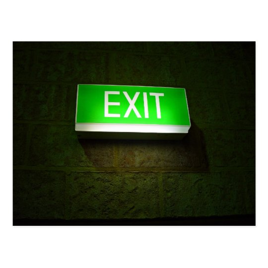 Glowing EXIT sign board on wall Postcard