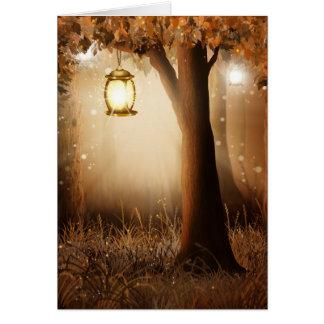 Glowing Lantern Hangs in tree during autumn dusk Card