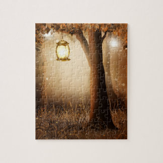 Glowing Lantern Hangs in tree during autumn dusk Jigsaw Puzzle