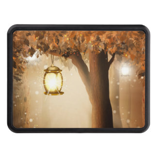 Glowing Lantern Hangs in tree during autumn dusk Trailer Hitch Cover