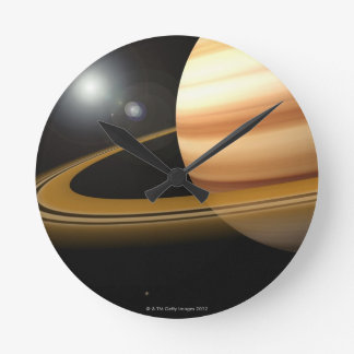 Glowing Stars and a Moon of Saturn Round Clock