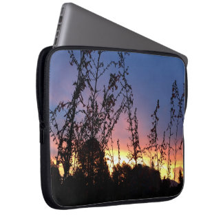Glowing Sunrise and Wildflower Silhouette Sunrise Laptop Sleeve