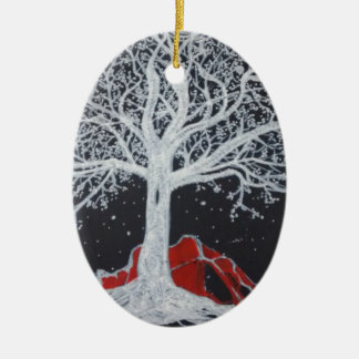 Glowing tree of life on a black background ceramic oval ornament