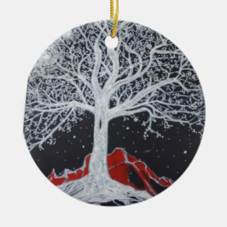 Glowing tree of life on a black background round ceramic ornament