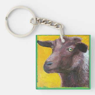 Goat face on yellow background key chain