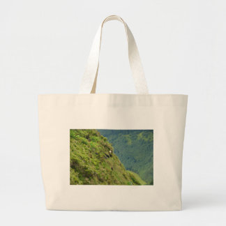 Goats on a very steep hillside tote bags