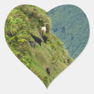 Goats on a very steep hillside heart sticker