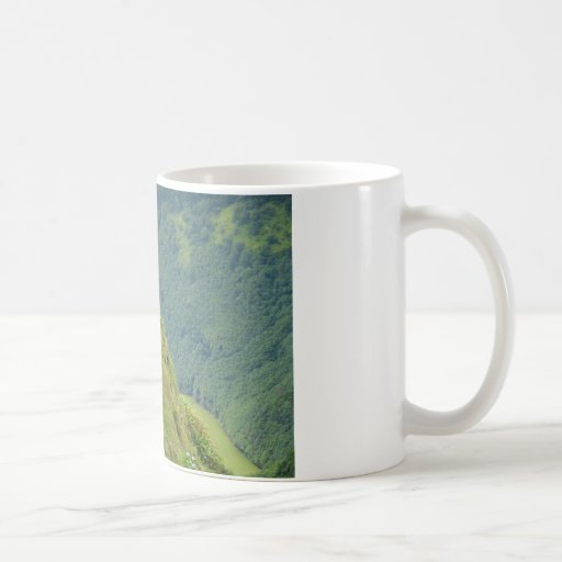 Goats on a very steep hillside coffee mug