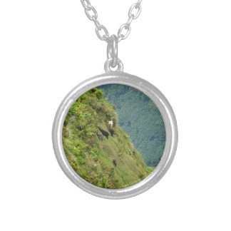 Goats on a very steep hillside necklace