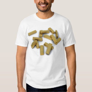 Gold bars in bulk on a white background tees