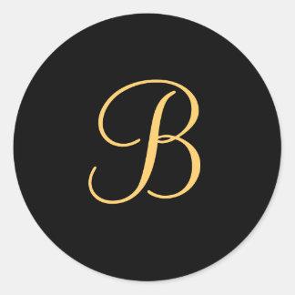 Gold-colored initial B on black monogram sticker