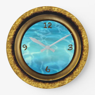Gold framed wall clock with blue water face.