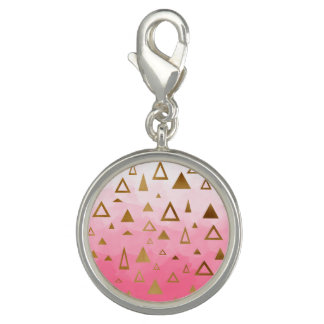 gold geometric triangles pastel pink brushstrokes charms
